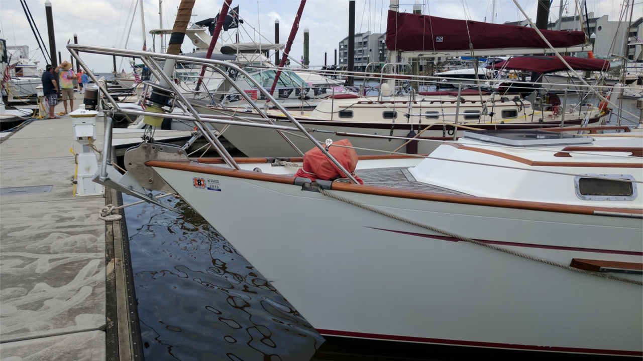 Mantus on Bow of Sailboat
